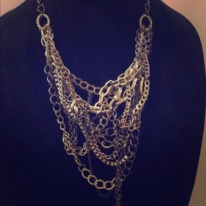 Tangled and knotted mixed metal bib necklace